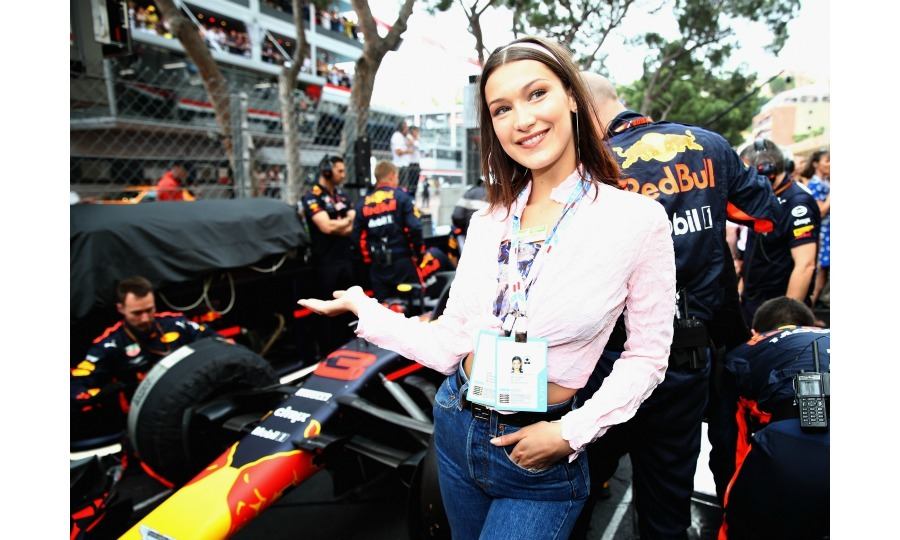 Looking casually chic, Bella Hadid stopped for a photo next to the Red Bull Racing team on the grid ahead of the major race.