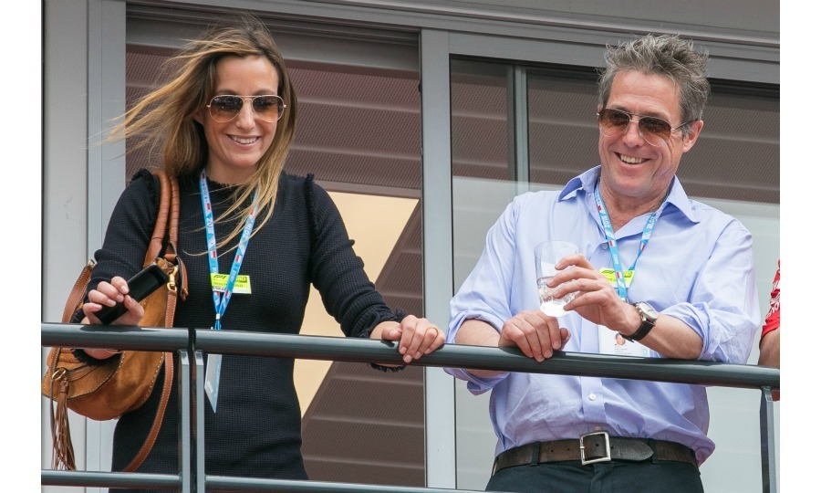 The happy couple walked inside the VIP paddock, quickly stepping out onto the balcony to see the view from above.
