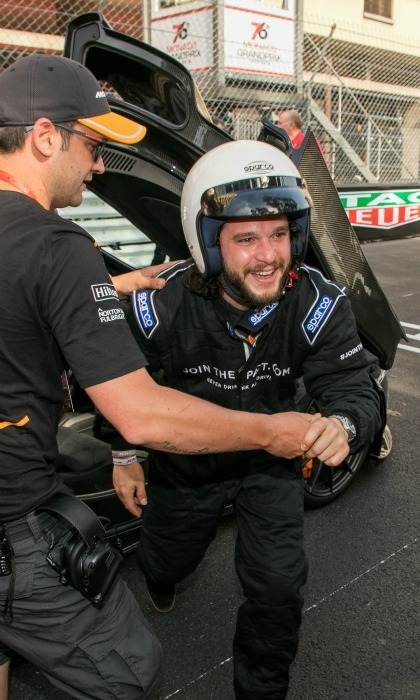 Start your engines! Kit Harrington was all smiles as he suited up and hopped into a race car.