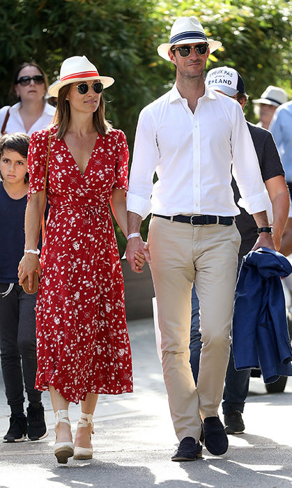 <p>The mother- and father-to-be took the Paris for the French Open on May 27. Looking stunning in a $600 red-and-white Ralph Lauren dress, Pippa Middleton showed off her growing baby bump, while her husband, James Matthews, looked dapper in khakis and a crisp white button up. To make matters even sweeter, the loved-up couple even donned matching hats to shield themselves from the Parisian sun!