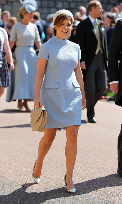 <p>Eugenie stunned in a light blue dress by Gainsbourg, clutch by M2Malletier and Valentino heels for Meghan Markle and Prince Harry's wedding on May 19.