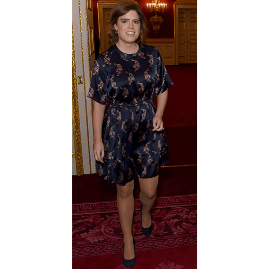 <p>Eugenie was all smiles in a navy printed frock dress.