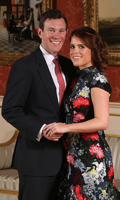 <p>Congratulations, Jack and Eugenie! The newly engaged couple posed in the Picture Gallery at Buckingham Palace on Jan. 22 after the announcement of their engagement. The Queen's granddaughter stunned in a floral Erdem dress and Jimmy Choo pumps, plus her breathtaking pink sapphire engagement ring!