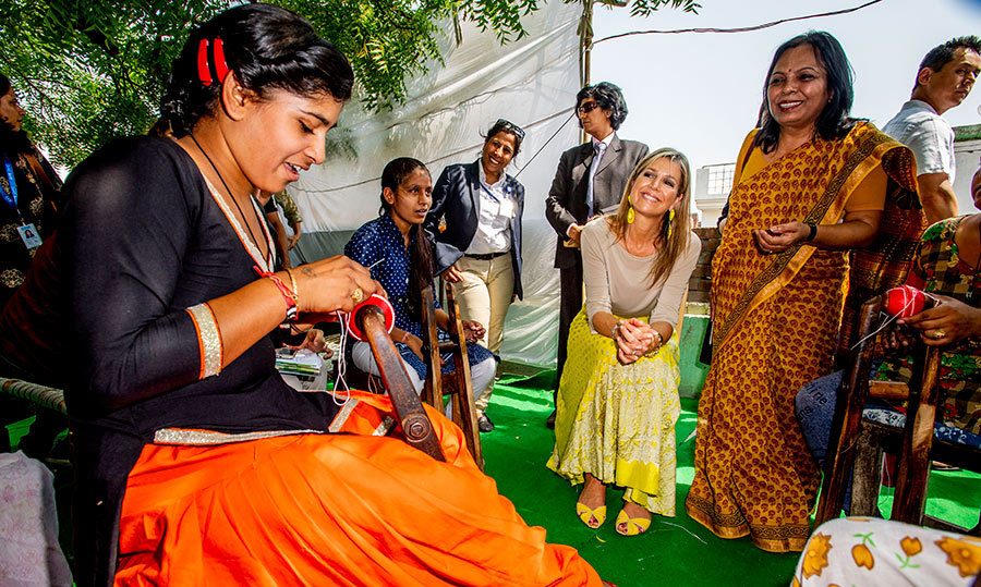 <p>Queen Maxima chatted with a woman who was busy demonstrating how to create a cricket ball.