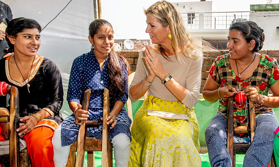 <p>Maxima, dressed in a beautiful yellow skirt, thanked the women who showed her how to create cricket balls. The group were all smiles!