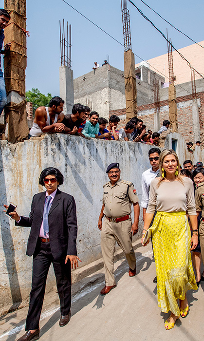 <p>Members of the community watched on as the sunny royal strolled down the streets of Meerut. 