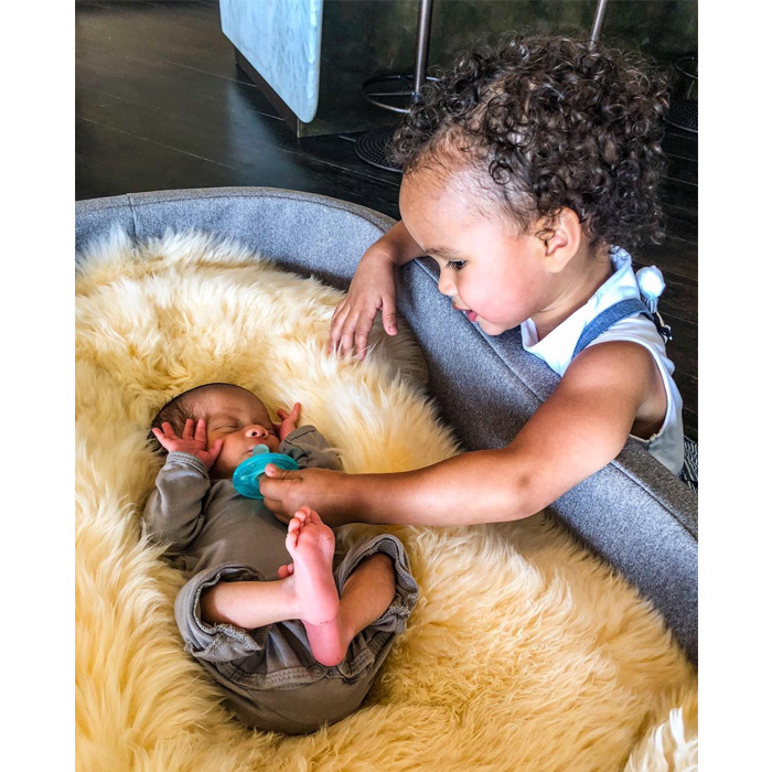 <p>Be still our beating hearts! Chrissy Teigen shared the sweetest photo of her and John Legend's two-year-old daughter, Luna, having some bonding time with her newborn baby brother, Miles, who is only 13 days old. The supermodel captioned the photo simply with a heart emoji.