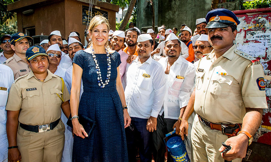 <p>Queen Maxima paid a visit to a group of lunchbox carriers, locally known as Dabbawallas, in Mumbai while on her three-day trip to India.