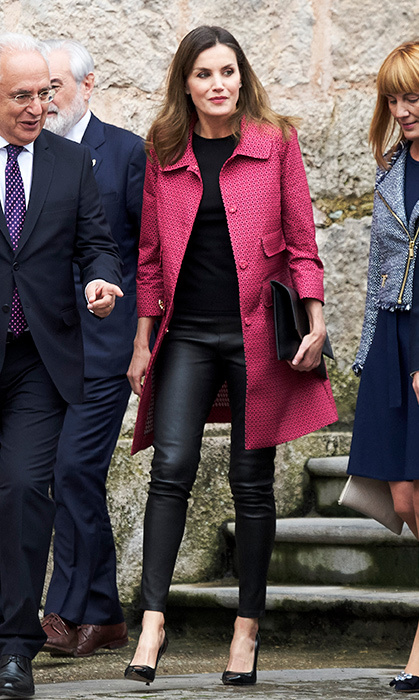 <p>The queen of fashion strikes again! Queen Letizia stepped out to celebrate the opening of XIII International Seminar on Language and Journalism on May 29. The royal stunned in a raspberry Atos Lombardini coat, Uterque leather leggings, a black clutch and black Carolina Herrera pumps.