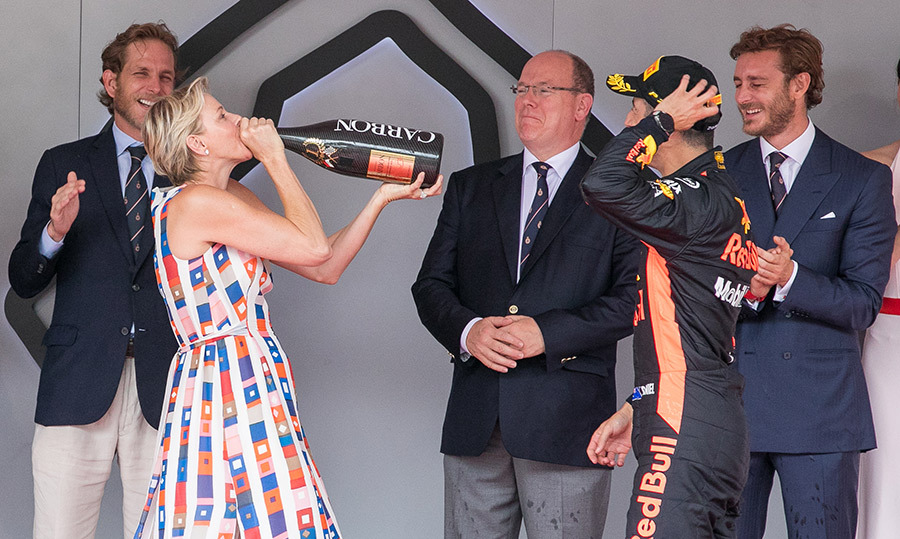 <p>Princess Charlene took a sip of the bubbly on the podium during the Monaco Formula One Grand Prix on May 27.