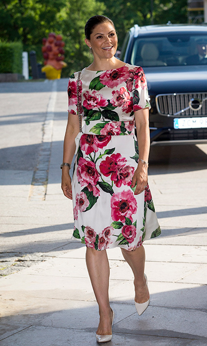 <p>Crown Princess Victoria stunned in pink florals while attending the annual meeting of the friends of the National Museum at the Modern Museum on May 29.