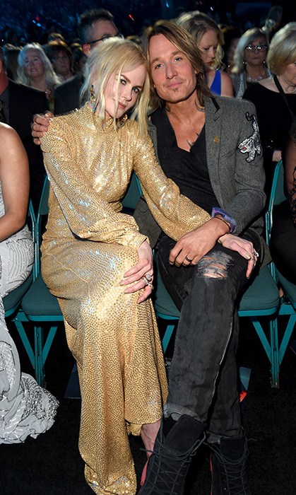 <p>Nicole and Keith cozied up at the 2018 ACM Awards, where the blonde beauty was clad in a custom gilded Michael Kors Collection gown and her hubby wore an embroidered blazer with distressed jeans.