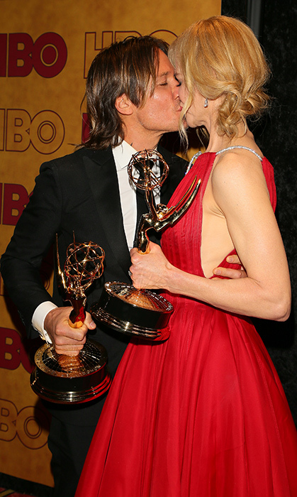 <p>Sealed with a kiss! No one was more proud of Nicole than her husband Keith as she picked up her first-ever Emmy wins at the 2017 ceremony.