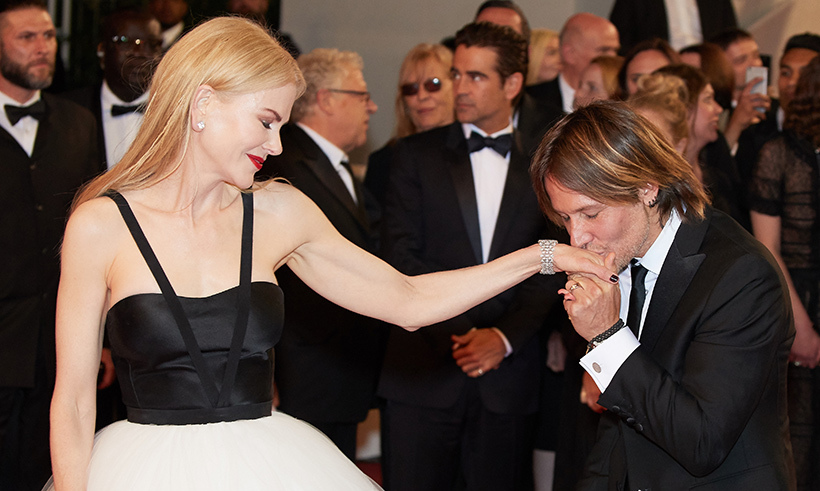 <p>A kiss for the lady! Keith planted a smooch on his wife's hand while they brought romance to the 2017 Cannes red carpet in France.