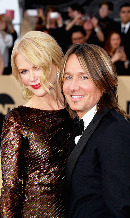 <p>Nary a red carpet goes without a little Nicole and Keith loved-up action! The two posed for a photo while attending the SAG Awards in 2018, at which Nicole took home a statue for her work on <em>Big Little Lies</em>.