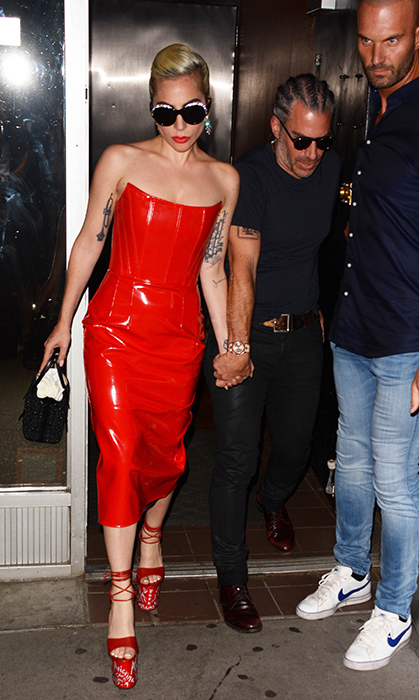 Hand in hand with her boyfriend Christian Carino, Gaga looked red hot in a leather Giusdeppe Di Morabito dress, Alain Mikli x Alexandre Vauthier sunglasses, an Alaia bag and sky-high Vivienne Westwood platforms.