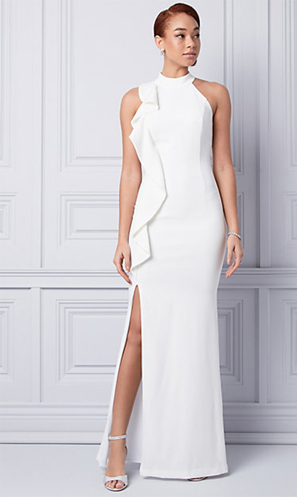 "<strong>Triacetate Halter Neck Ruffle Gown, $325, <a href=""https://www.lechateau.com/style/jump/BRIDAL356321_003/productDetail/White+%26+Ivory/BRIDAL356321_003/cat38761590"">lechateau.com</a></strong>"
