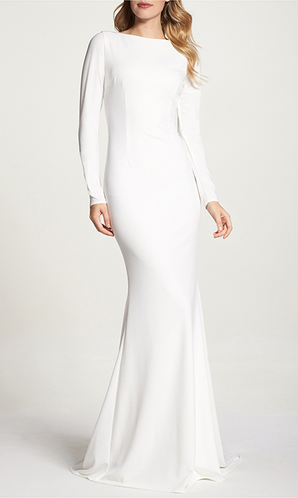 "<strong>Noel and Jean by Katie May Cowl Back Crepe Gown, $1,204, <a href=""https://shop.nordstrom.com/s/noel-and-jean-by-katie-may-cowl-back-crepe-gown-nordstrom-exclusive/4873550?origin=category-personalizedsort&breadcrumb=Home%2FWomen%2FThe%20Wedding%20Suite&color=ivory"">nordstrom.com</a></strong>"