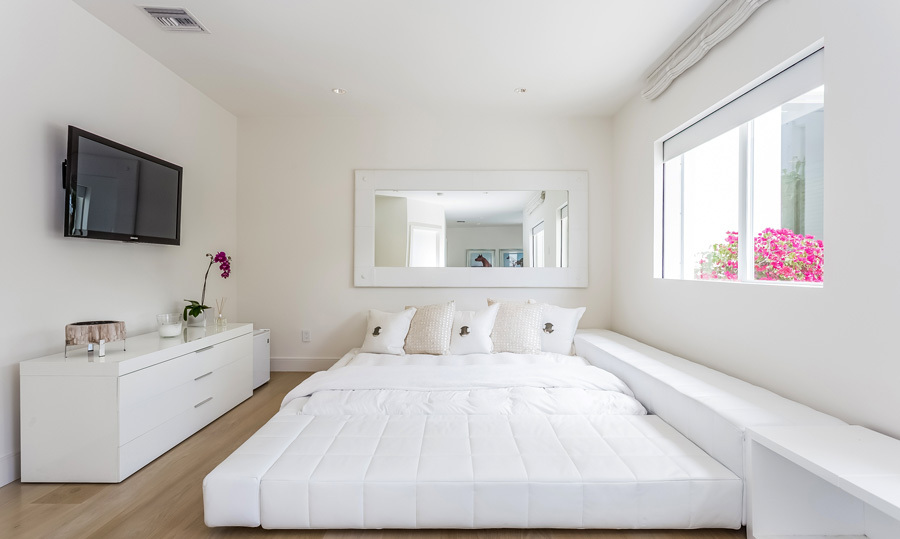 The clean tones and crisp finish carries over into the bedrooms. The six rooms have minimal furniture and optimal space for sleeping or taking in the waterfront skyline.