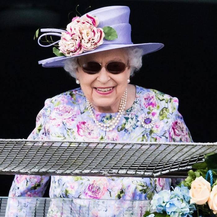 The Queen was all smiles while attending the Epsom Derby! Looking ready for spring, Her Majesty donned a stunning floral lilac ensemble and didn't disappoint with her choice of hat.