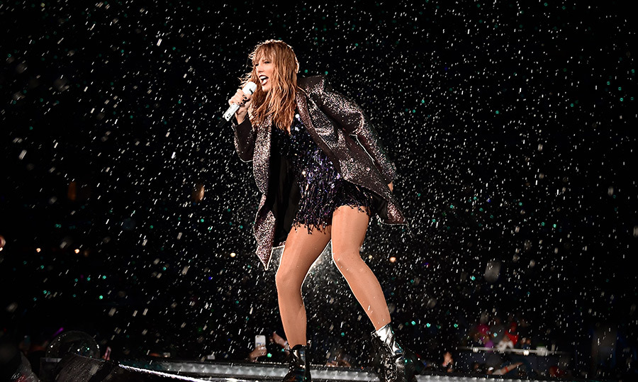Nobody rains on Taylor Swift's parade! Unless, of course, it's planned to happen at one of her live shows. The star took to the stage in Chicago at Soldier Field on June 2.