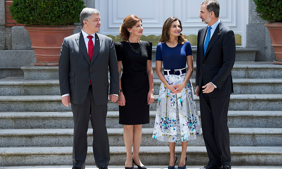 Queen Letizia and King Felipe VI of Spain met with Ukrainian President Petro Poroshenko and his wife Maryna Poroshenko (2L) at the Zarzuela Palace on June 4. Letizia looked her typical stylish self in a floral skirt and navy top, while Maryna kept things simple and chic in a black dress.