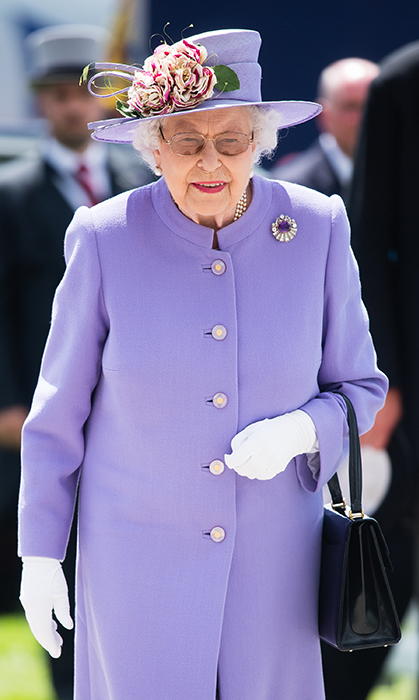 The Queen stepped out in the most beautiful lilac ensemble for the Epsom Derby on June 2.