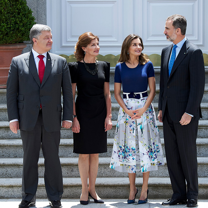 Queen Letizia wore blue floral perfection while welcoming the Ukranian President and his wife. She paired the light-coloured skirt with a simple navy blue top and black pumps.