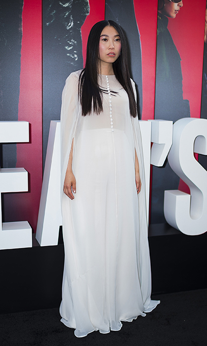 Awkwafina looked truly ethereal in a white Reem Acra dress, Giuseppe Zanotti shoes, Hueb earrings and Ivy NY rings.