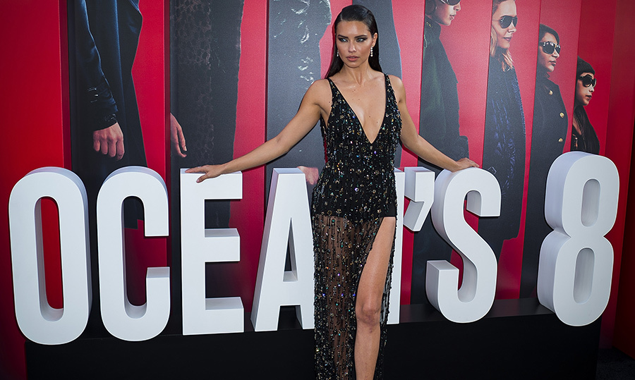 Adriana Lima showed off her ultimate supermodel look in a beautiful low cut black Roberto Cavalli gown.