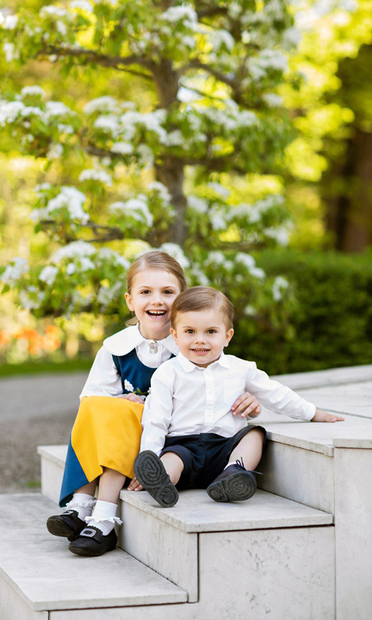 Princess Estelle posed with her little brother, Prince Oscar, for a special portrait marking 2018's Swedish National Day. The future Queen looked sweet as can be wearing the  traditional yellow, blue and white ensemble that her mother and aunts will also don later for the annual carriage procession. The photo was taken at Crown Princess Victoria and Prince Daniel's home, Haga Palace.
