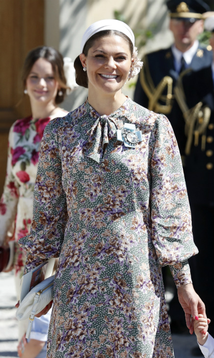 Crown Princess Victoria of Sweden smiles at the crowds gathered outside the chapel. Like her sister, the mother of two embraced florals for the special occasion, adding pops of white to complete her look.  