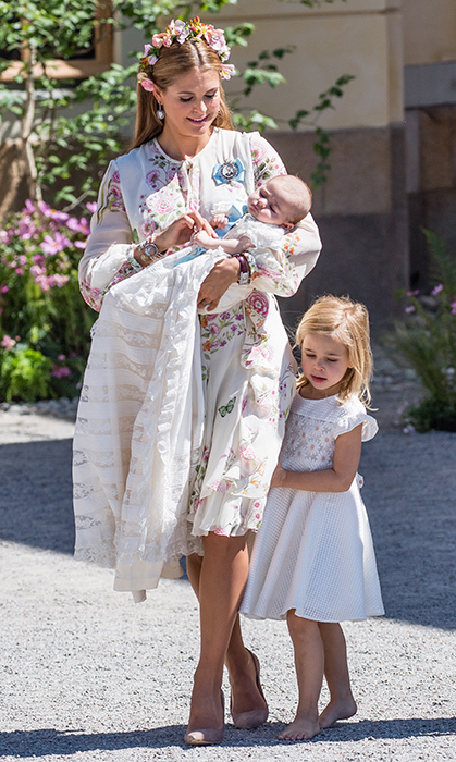 The Swedish royals looked absolutely stunning for Princess Adrienne's christening. Her gorgeous mom, Princess Madeleine, dazzled in spring florals, pairing the look with nude heels and a flower crown. Free-spirited Princess Leonor looked totally adorable in a simple white summer dress and bare feet!