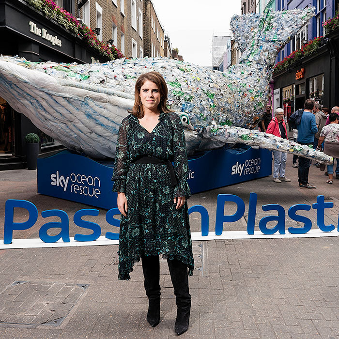 Princess Eugenie wore a dark floral dress and knee-high black suede boots during the launch of 'Pass on Plastic', an exclusive pop up from Project 0 and Sky Ocean Rescue.