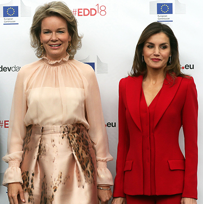 Queen Mathilde of Belgium and Queen Letizia of Spain were fashion forces during the opening ceremony of the 'European Development Days' on June 5. The Spanish royal stunned in a powerful all-red suit, while Mathilde opted for a pretty cream skirt with a similarly coloured high-neck blouse.