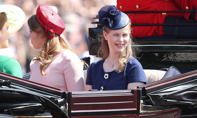 Sophie, Countess of Wessex, and Prince Edward's teenage daughter Lady Louise looked simply elegant in a navy blue ensemble. The Queen's 14-year-old granddaughter rode in a carriage alongside her proud mother and cousins Princesses Beatrice and Eugenie. 