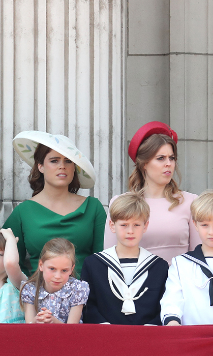 Sisters Princess Eugenie (L) and Princess Beatrice also embraced colour for their grandmother's birthday party. Beatrice, 29, opted for a blush pink dress teamed with a red hat, while Eugenie, 28, looked lovely in emerald green with an embroidered hat.
