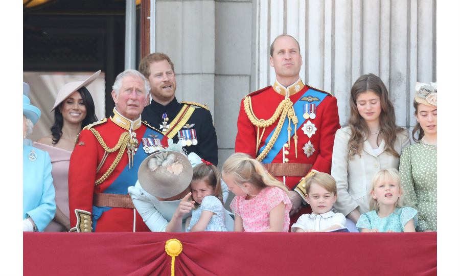 Princess Charlotte got upset when she fell off the bench the children were standing on, but her doting mom was quick to comfort her while cousin Savannah Phillips looked on. 