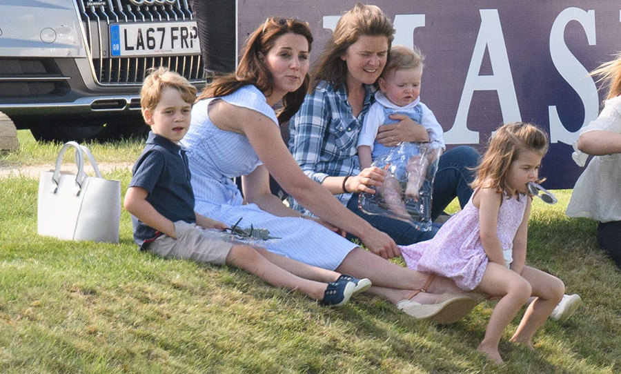 The Cambridge kids – minus Prince Louis – sat in the grass to watch dad, Prince William, compete in the polo match