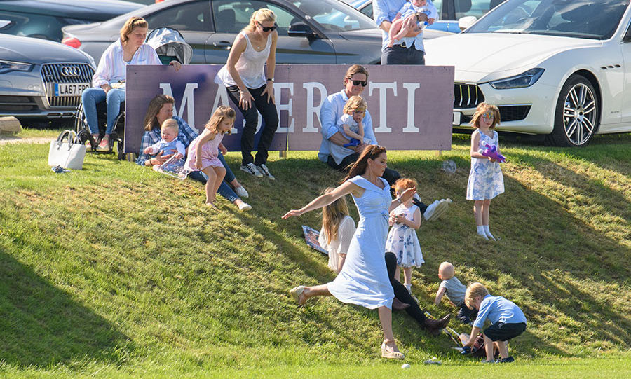 Known for a love for sports, Kate ran around and played with the kids while at the polo match.