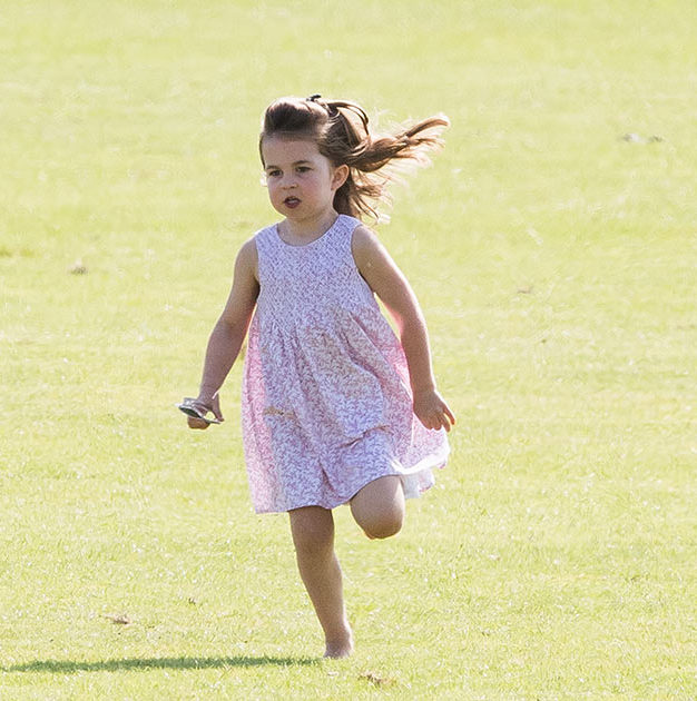 Princess Charlotte could not be slowed down! She looked adorable in her pink summer dress, running through the grass barefoot.