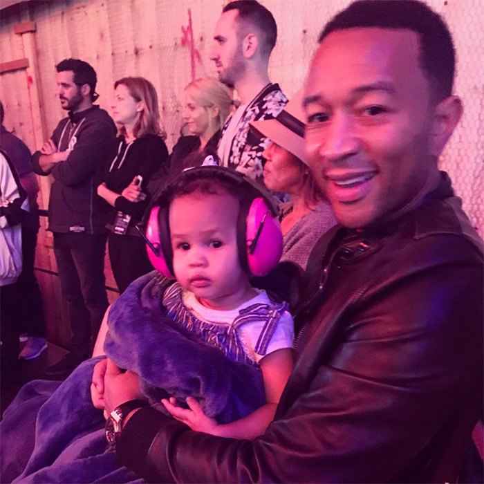 From helping them swim to singing songs on <em>Sesame Street</em>, it's clear that John Legend will do just about anything for his kids, two-year-old Luna and one-month-old Miles. Here's a look at some of the most endearing family moments he and wife Chrissy Teigen have shared on social media.