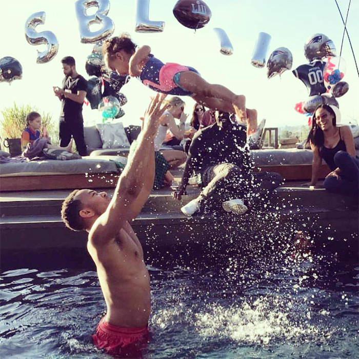 "Swimming never looked more fun than it does in this shot from February at a Super Bowl party. John captioned the snap, ""#FlyLunaFly.""