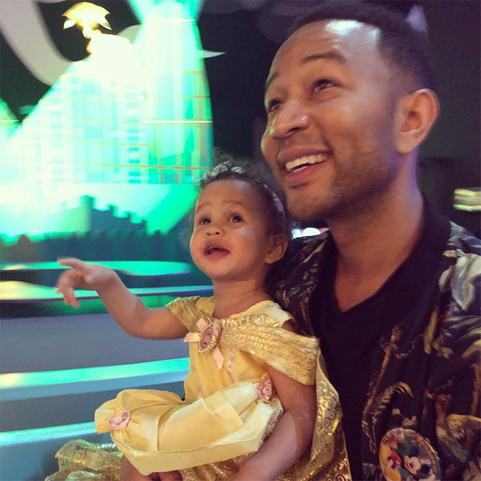 "Clad in her Princess finest, Luna had a ball riding ""It's a Small World"" at Hong Kong Disneyland - and her dad looks just as excited to be there!