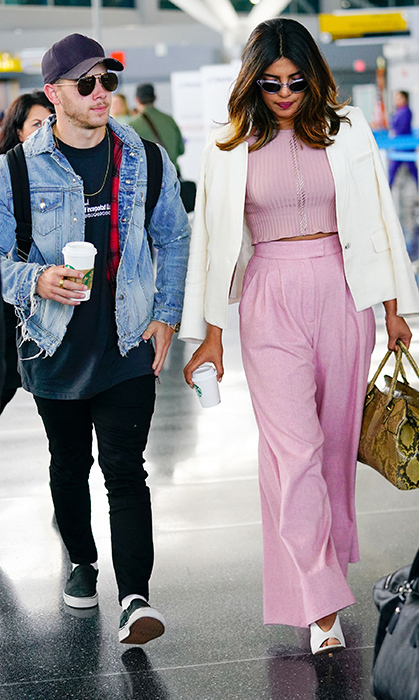 The couple was spotted on June 8 arriving at JFK airport in New York City. Looking her typical fashion forward self, Priyanka stunned in a pink monochrome outfit, while Nick kept it casual in black jeans and a blue denim jacket. The two were in town to attend Nick Jonas' cousin's wedding – and Priyanka was the singer's plus one.