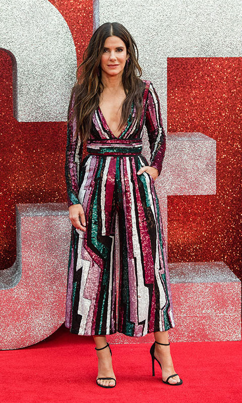 Sandra Bullock's sequinned Zuhair Murad jumpsuit brought a hearty dose of glitz and glamour to the red carpet. She let the striking piece do the talking, keeping accessories to a minimum.