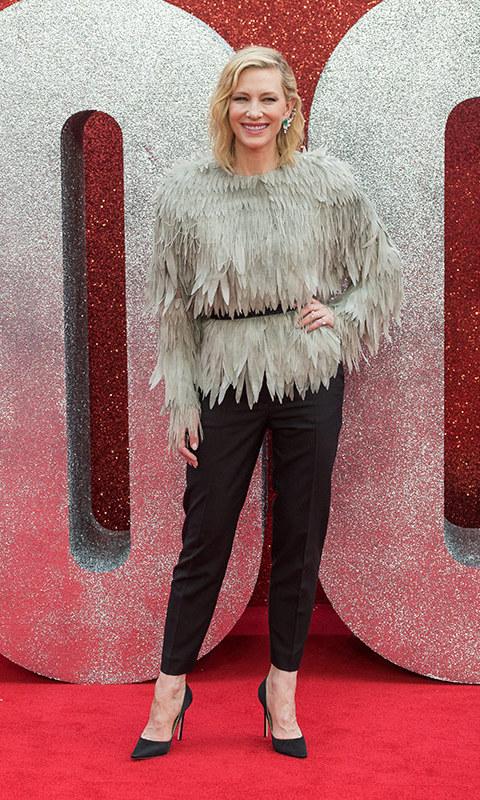 Cate Blanchett's feathery topper came courtesy of Louis Vuitton. The blond beauty anchored the look with sleek black pants and black pants and topped it off with an oversized, embellished ear climber.