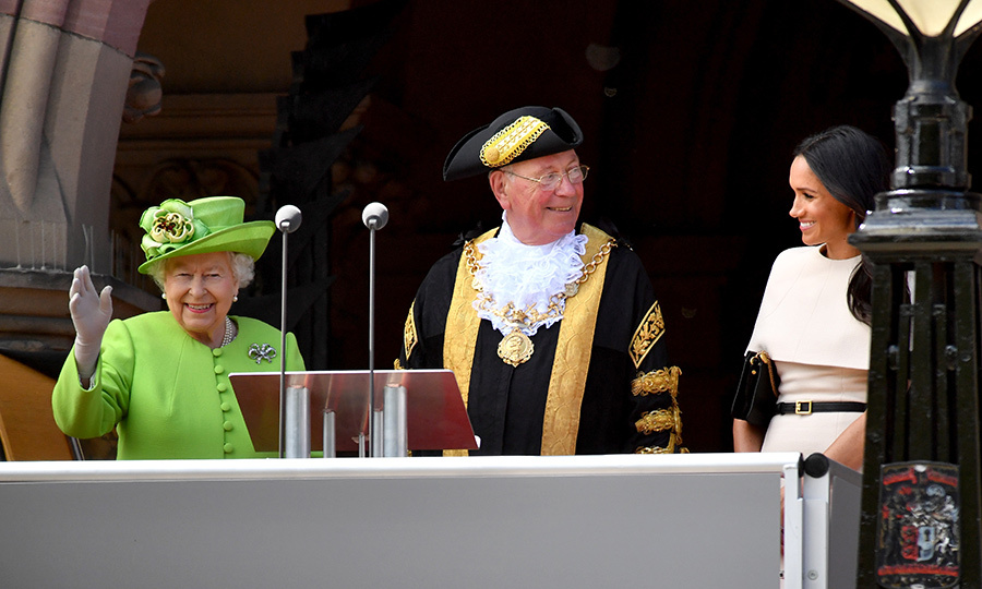 The Queen waved to a crowd of adoring fans from the podium in Chester, where she and Meghan stood flanking the Mayor at City Hall for a plaque unveiling.