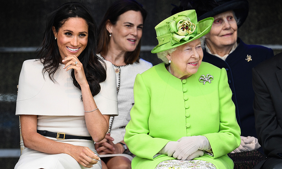 Seated behind the pair is Samantha Cohen, the  Queen's former special adviser who is helping the Duchess in her first six months  as a royal.