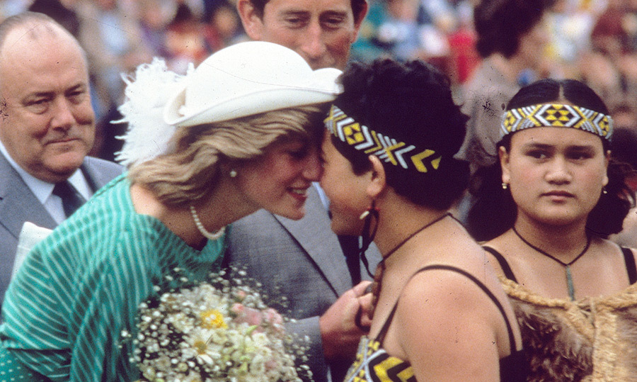 Princess Diana and Prince Charles spent time learning about the rich history of New Zealand. They made a stop in the capital of Auckland at Eden Park Stadium to greet a group of traditional Maori women and learn about their culture. Diana shared a traditional hongi nose rub with one woman, a greeting we've seen Harry undertake in the past but that he's likely practicing with his new wife ahead of their visit.